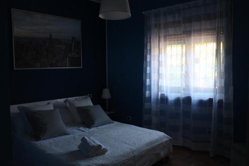 Vuode tai vuoteita majoituspaikassa Casa Vacanze Family and Friends
