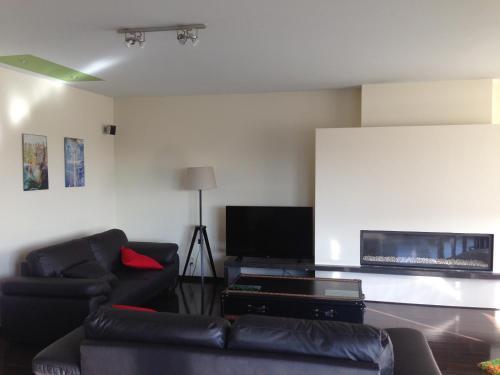 Ein Sitzbereich in der Unterkunft Comfort Aan Zee Penthouse