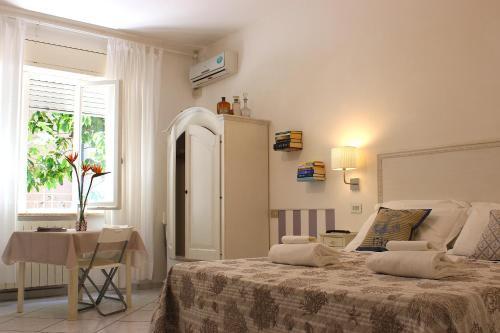 Letto o letti in una camera di Soggiorno Tagliaferro