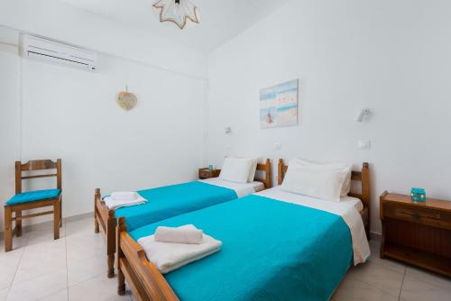 A bed or beds in a room at Annabel Apartments