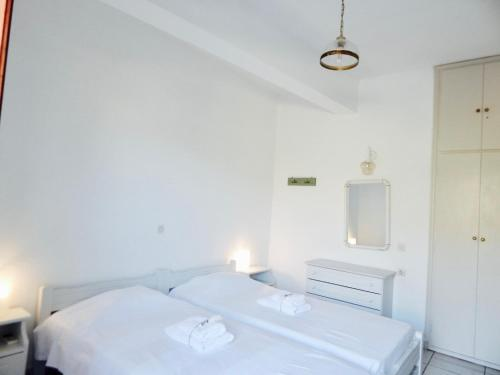 A bed or beds in a room at Filio Apartments