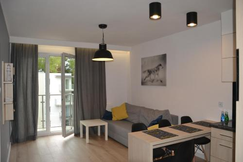 A seating area at Apartament Lesny Zakatek