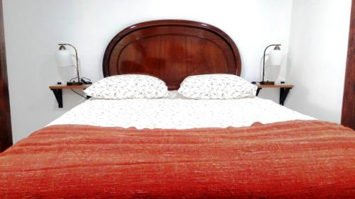 A bed or beds in a room at Embaixador, 70