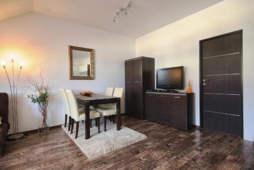 Telewizja i/lub zestaw kina domowego w obiekcie Apartament SunForYou