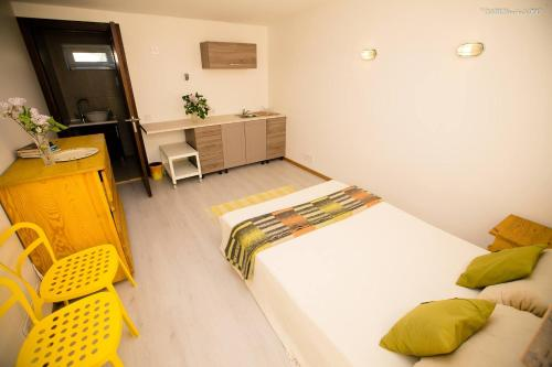 A bed or beds in a room at Alytus Guesthouse