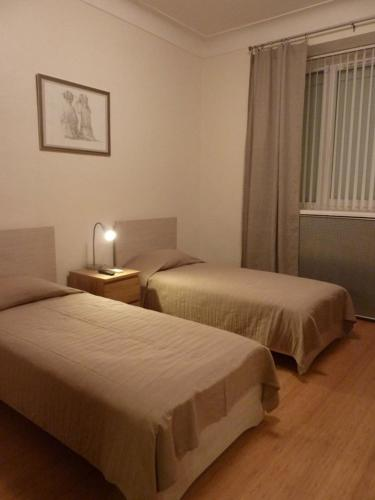 A bed or beds in a room at Rusapart on Zubovsky