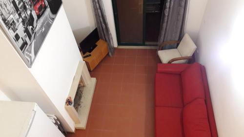 A seating area at Apartamento Verde Pino