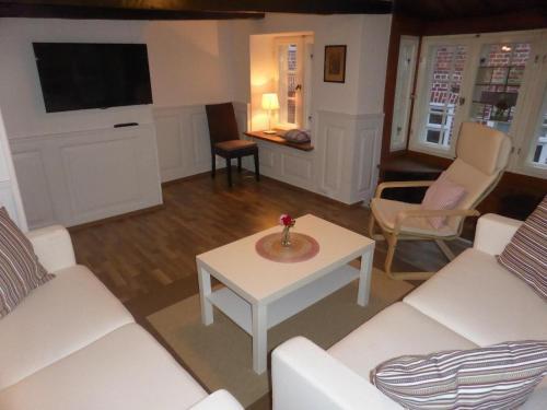 Ein Sitzbereich in der Unterkunft Altstadt Lüneburg Ferienwohnung Neue Strasse-Auf dem Meere