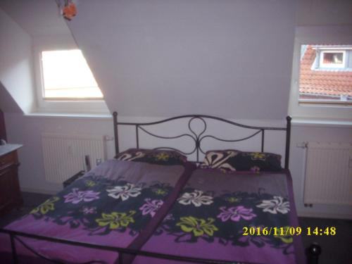 A bed or beds in a room at Citywohnung