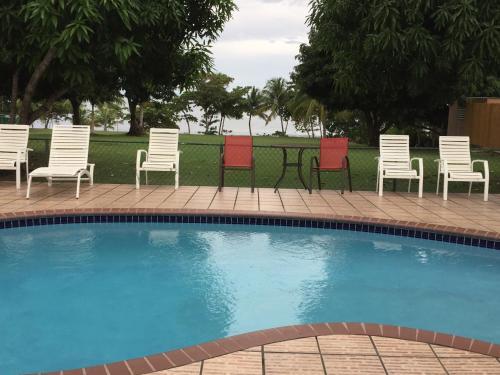 The swimming pool at or near Tres Palmas Inn and Villas