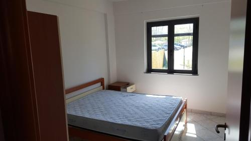 A bed or beds in a room at Villaggio del Golfo