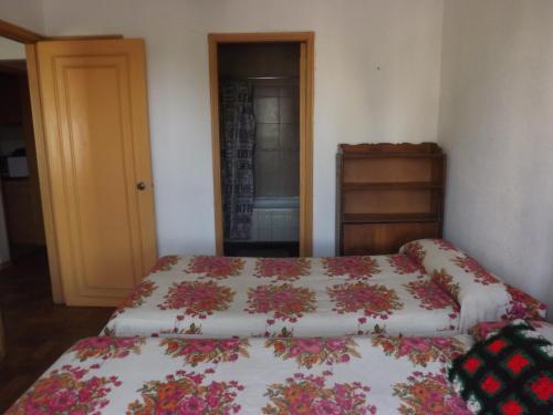 Cama o camas de una habitación en Departamento El Quinto Piso