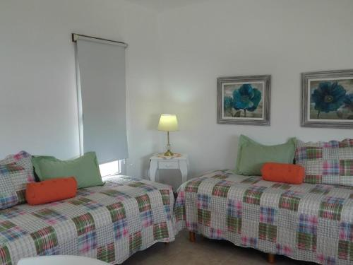 Una cama o camas en una habitación de Los Abrojos 3
