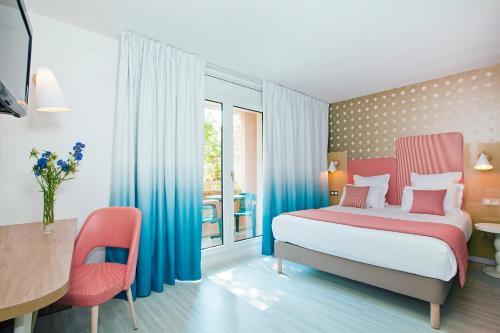 Un ou plusieurs lits dans un hébergement de l'établissement Residhome Nice Promenade