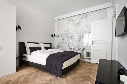 Posteľ alebo postele v izbe v ubytovaní 1891 Aparthotel