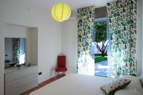 Letto o letti in una camera di Vacation Home Agrumeto Flegreo