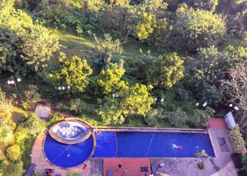 A view of the pool at TechieRoom Kotlin at Clove Garden Residence or nearby