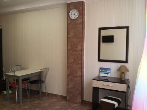 A television and/or entertainment center at Apartments Sukhumskie