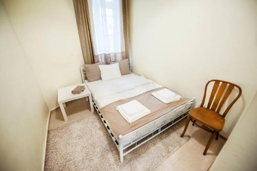 A bed or beds in a room at KRK Apartments