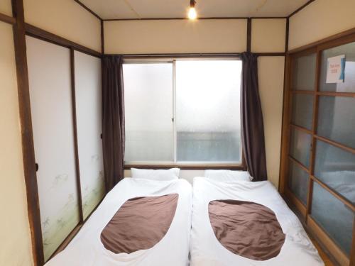 ゲンタ ホステル 東京 スペース 青砥にあるベッド