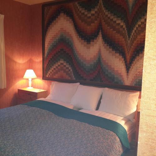 Un ou plusieurs lits dans un hébergement de l'établissement Gîte B&B - Haute Savoie - Chez Louise