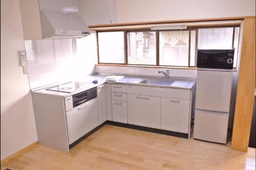 A kitchen or kitchenette at Uwa Guest House