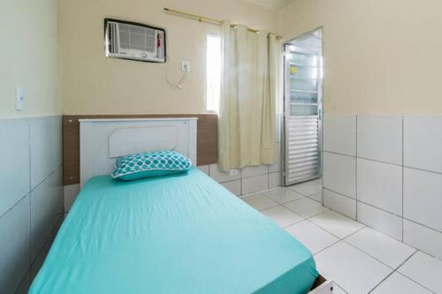 Cama ou camas em um quarto em Temporada Casa na Ilha de Itamaracá