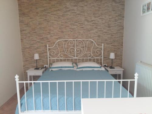 Un ou plusieurs lits dans un hébergement de l'établissement Apartment Plaisir