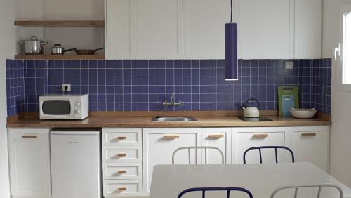 A kitchen or kitchenette at Aparthotel Fleming 50 - Adults Only
