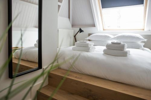 A bed or beds in a room at City Boutique Apartment