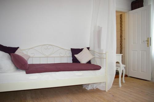 Ein Bett oder Betten in einem Zimmer der Unterkunft Kaiserhof Goldenbek