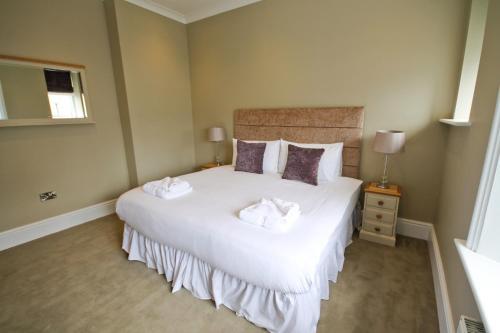 Giường trong phòng chung tại Llys yr Onnen
