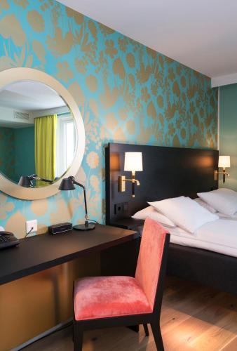 Een bed of bedden in een kamer bij Thon Hotel Nidaros