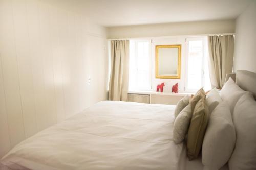 Ein Bett oder Betten in einem Zimmer der Unterkunft Stylish Apartment in the Heart of Zug by Airhome