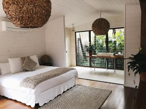 A bed or beds in a room at The Boathouses at Leaves & Fishes