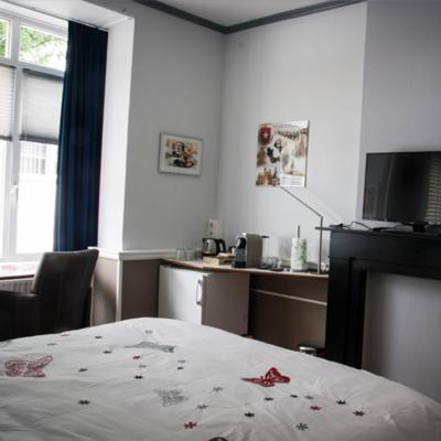 A bed or beds in a room at Het Harlekijntje