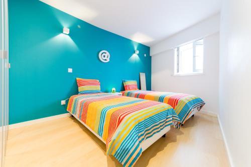 Cama ou camas em um quarto em Apartamento centro Leiria