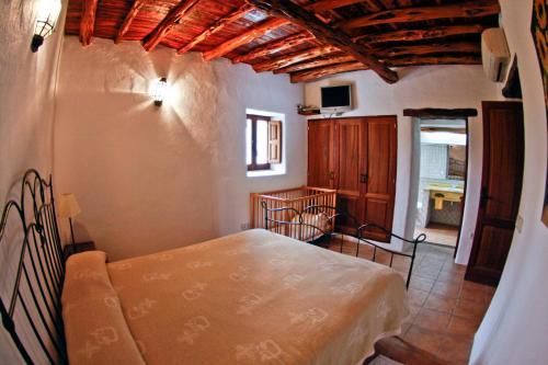 A bed or beds in a room at Holiday Villa Casa Calma Ibiza