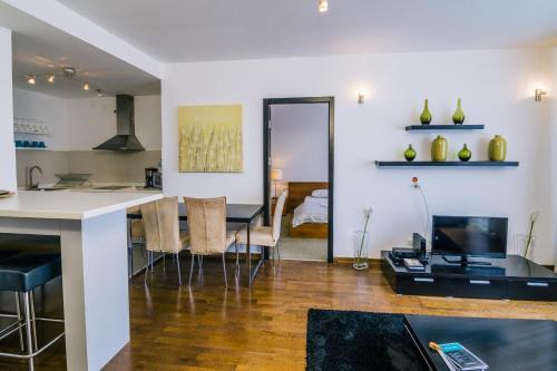 Virtuvė arba virtuvėlė apgyvendinimo įstaigoje City Gardens Hotel & Wellness