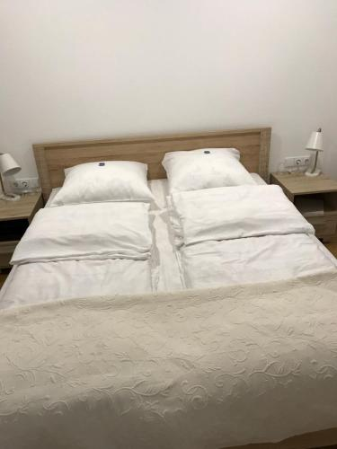 Lova arba lovos apgyvendinimo įstaigoje Laisves Luxury Apartaments