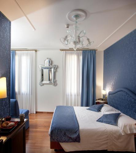Giường trong phòng chung tại Hotel Ca' D'Oro