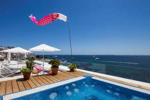 The swimming pool at or near Sud Ibiza Suites