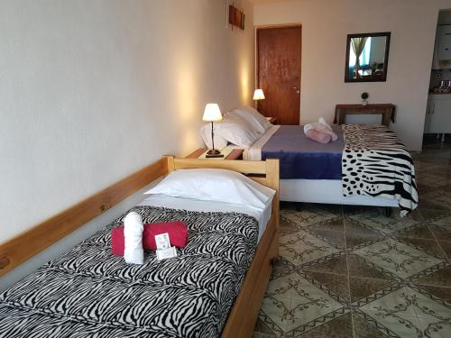 A bed or beds in a room at Bahía Nevada