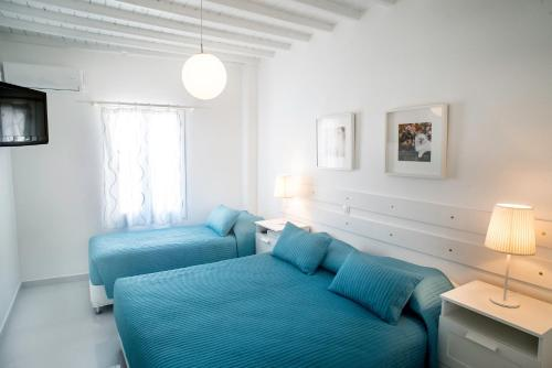 A bed or beds in a room at Chora House