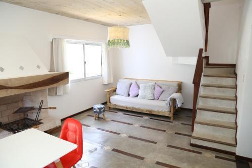 A seating area at Alma de La Pedrera - Villaggio & Spa