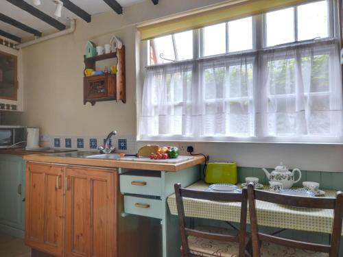 A kitchen or kitchenette at English Cottage in Hastings Kent with Coal Burning Stove