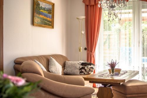 Ein Sitzbereich in der Unterkunft Apartment Müller