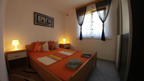 Krevet ili kreveti u jedinici u objektu Apartments Ayla