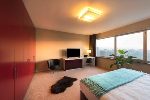 A television and/or entertainment center at Htel Serviced Apartments Amsterdam