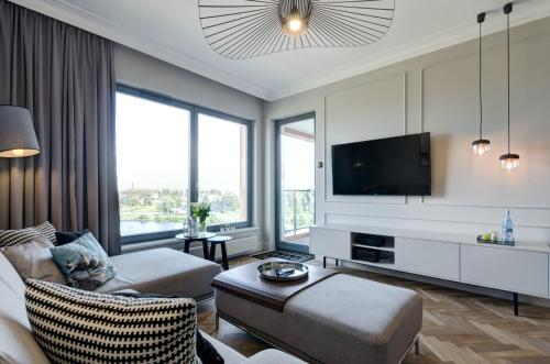 A television and/or entertainment center at Motlawa Premium Apartment